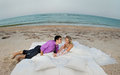 Young couple resting in bed beautiful morning on the beach Stock Photography