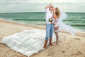 Young couple resting in bed next to on beach Royalty Free Stock Photo
