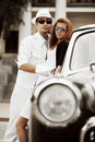 Young couple with a retro car Royalty Free Stock Images