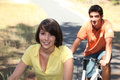 Young couple riding bikes country Stock Photo
