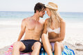 Young couple romancing on the beach a sunny day Royalty Free Stock Image