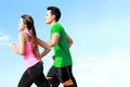 Young couple running together sporty asian outside Stock Images