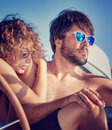 Young couple on sailboat closeup portrait of beautiful sitting and enjoying sunny summer day active lifestyle romantic vacation in Royalty Free Stock Photo
