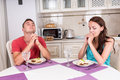 Young Couple Saying Grace Before Eating Meal Royalty Free Stock Photo