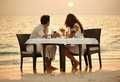A young couple share a romantic dinner Stock Photography