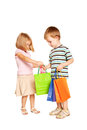 Young couple with shopping bags children isolated on white background Stock Photography