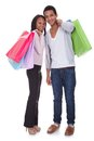 Young couple with shopping bags portrait of over white background Royalty Free Stock Photos