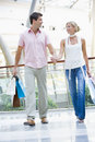 Young couple shopping in mall Royalty Free Stock Photography