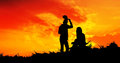 Young couple silhouette looking sunset at doi inthanon chiangmai thailand Royalty Free Stock Photo
