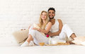 Young Couple Sit On Pillows Floor, Happy Hispanic Man And Woman Breakfast Tray Lovers In Bedroom Royalty Free Stock Photo