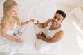 Young Couple Sitting In Bed, Smiling Woman Man Hold Condom Lovers Contraception Protection Royalty Free Stock Photo