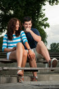 Young couple sitting on a bench Stock Photo