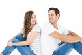 Young couple sitting on floor back to back