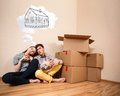 Young couple sitting on the floor and daydream about new home Royalty Free Stock Photo