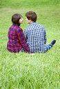 Young couple sitting on grass Royalty Free Stock Photo