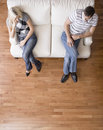 Young Couple Sitting on Love Seat Stock Photos