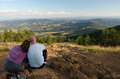Young couple sitting on mountain top in summer Royalty Free Stock Photo