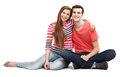 Young couple sitting over white background Royalty Free Stock Photography