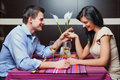 Young couple sitting in restaurant and flirting drinking wine Royalty Free Stock Images