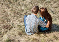 Young couple sitting together in park Stock Photos
