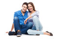 Young couple smiling over white background Royalty Free Stock Photos