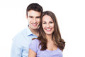 Young couple smiling over white background Royalty Free Stock Images