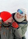Young couple on snow Stock Photography
