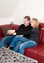 Young couple on sofa Stock Images