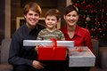 Young couple and son at christmas portrait happy holding presents smiling Royalty Free Stock Photo