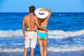 Young couple standing looking at the beach rear back view Royalty Free Stock Images
