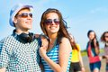 Young couple standing on the road having fun with friends Royalty Free Stock Photo