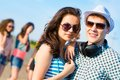 Young couple standing on the road having fun with friends Royalty Free Stock Photography