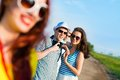 Young couple standing on the road having fun with friends Stock Photo
