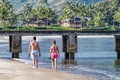 Young couple strolling beach, Kauai, Hawaii Royalty Free Stock Photo