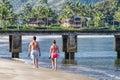 Young couple strolling beach, Kauai, Hawaii Royalty Free Stock Photo