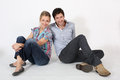 Young couple of students sitting down isolated Royalty Free Stock Photo