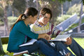 Young couple studying outdoors side view Stock Photo