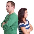 Young couple sulking after an argument Royalty Free Stock Image