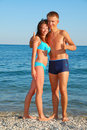 Young couple on summer beach Stock Photos