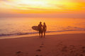 Young couple with surfboard dreamland beach bali indonesia dreamland is one of the most popular surfing areas of bali Stock Photo