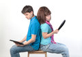 A young couple with a Tablet PC Stock Images