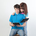 A young couple with a Tablet PC Royalty Free Stock Photography