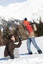 Young couple taking photos on the snow Royalty Free Stock Image