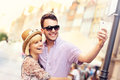 Young couple taking selfie while sightseeing the city a picture of a gdansk in poland Stock Photography