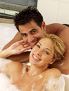 Young couple taking a shower Royalty Free Stock Photo