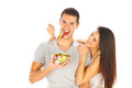 Young couple tasting a salad Stock Image