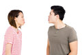 Young couple teasing each other on white background Royalty Free Stock Photos