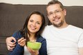 Young couple in their home cheerful with bowl of muesli interior Royalty Free Stock Photos