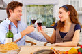 Young couple in their kitchen Royalty Free Stock Photography