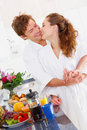 Young couple in their kitchen Royalty Free Stock Photo